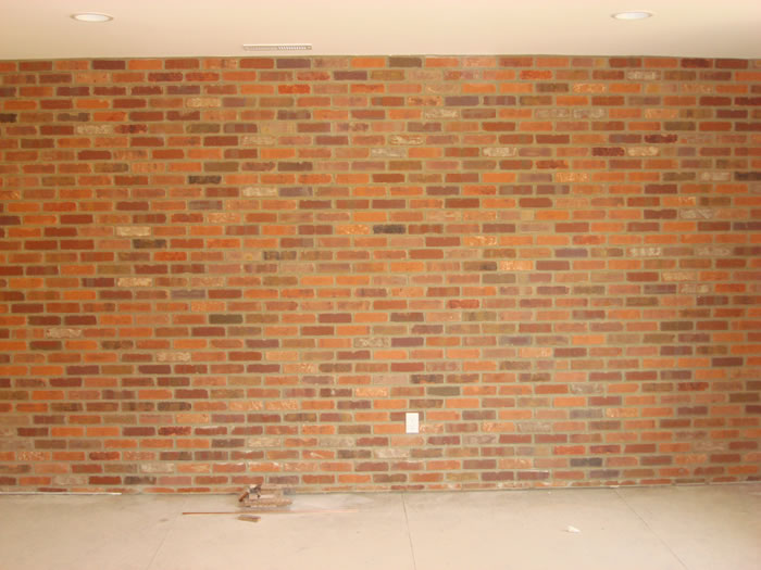 This Brick Facade Offers Interest To This Interior
